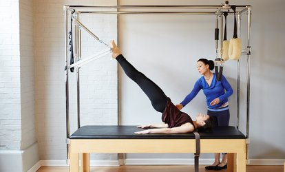 image for One or Three Private <strong>Pilates</strong> Lessons, or One-Month Unlimited Classes at Gyrotronic Jupiter (Up to 59% Off)