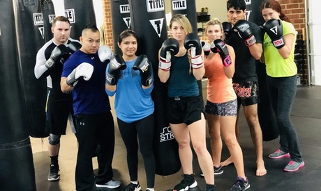 One Month of Fitness Kickboxing Classes or 10 Kickboxing Classes at ECF Martial Arts & Fitness (Up to 80% Off)