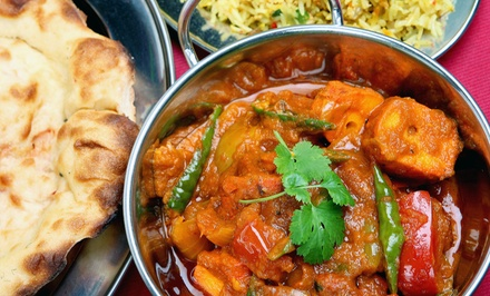 Indian Cuisine and Pizza at Curry & Crust Indian Cuisine & Desi Pizza (Up to 44% Off). Three Options Available.