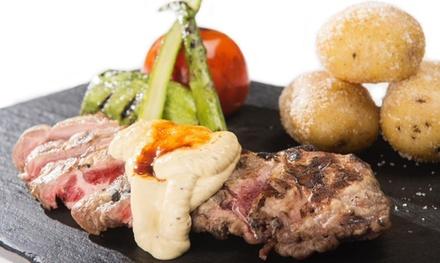 Menú para 2 o 4 con surtido de entrantes, 2 platos, postre y botella de vino o bebida desde 44,95€ en Restaurante Baluma