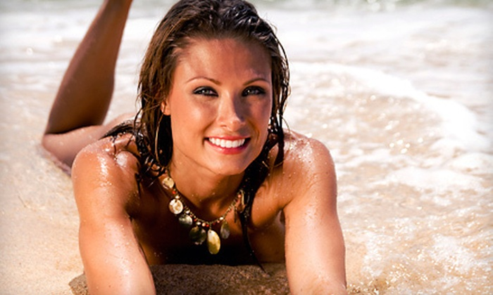 Total Tan - Multiple Locations: One Month of Unlimited Silver-Level Bed Tanning or One or Three Custom Airbrush Spray Tans at Total Tan (Up to 78% Off)
