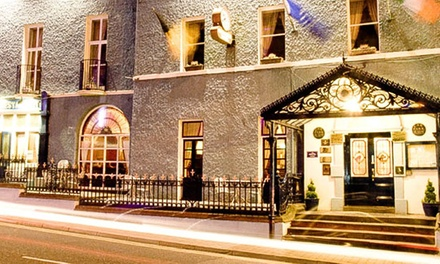 Kilkenny: 1 or 2 Nights for Two People with Breakfast, Dinner Credit and Wine at Club House Hotel