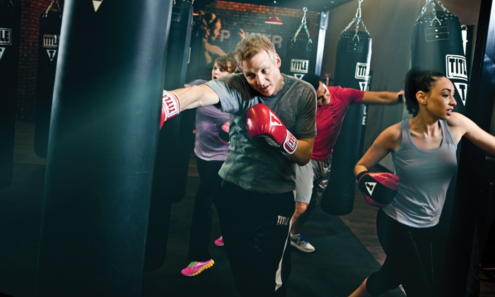 TITLE Boxing Club - Edmond: Two Weeks of Boxing and Kickboxing Classes at TITLE Boxing Club (57% Off)