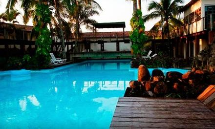Ilhabela/SP: até 5 noites para 2 pessoas + café da manhã no Hotel Petit Village. Digite NATAL e ganhe 10% OFF extra!
