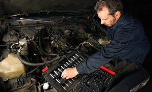 Midas: Maintenance Package with Oil Change and Air Filter or Brake Package with Pad Replacement at Midas (50% Off)