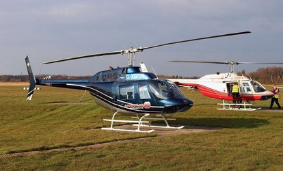 image for Winter Skies Helicopter Tour for One or Two with Adventure 001