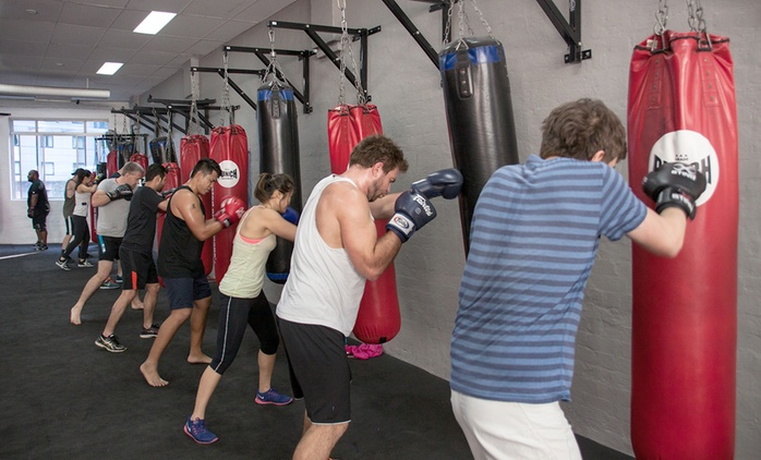 One Month of Unlimited Boxing Classes: One ($19) or Two People ($35) at Corporate Fitness Centre (Up to $392 Value)