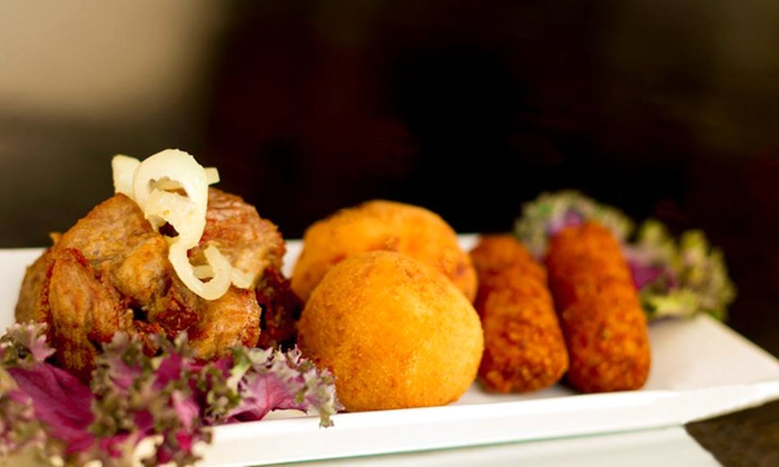 Bongos Cuban Café - Park West: Cuban Cuisine and Drinks for Two or Four at Bongos Cuban Café (Half Off)