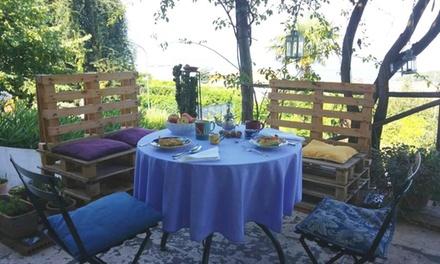 Menu profumi del giardino con vista Vesuvio