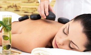 Tease Inc. Salon and Spa: $96 for Spa Package with Hot-Stone Massage and European Facial at Tease Inc. Salon and Spa ($175 Value)