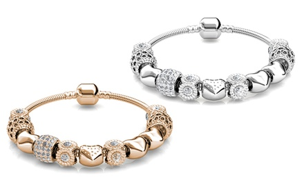 Hasta 4 pulseras con adornos y cristales de Swarovski® chapadas en oro de 18 quilates