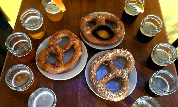 Belcourt Taps - Belcourt Taps: $14 for Two Beer Flights and Two Gourmet Pretzels for Two at Belcourt Taps ($27 Value)