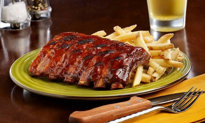 Tony Roma's Green Bay - Ashwaubenon: Appetizer and Entrees for Two or Four, or Steakhouse Cuisine at Tony Roma's Green Bay (Up to 50% Off)