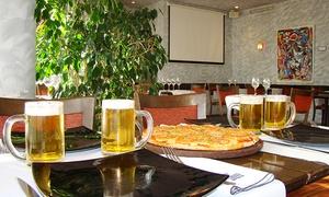 Simone Puerto Madero: Desde $199 por empanadas + pizza + cerveza para dos o cuatro en Simone Puerto Madero