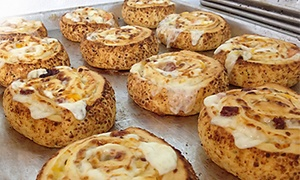 Pizza Pucks: Pizzeria Cuisine for Two or for Carryout at Pizza Pucks (Up to 39% Off)
