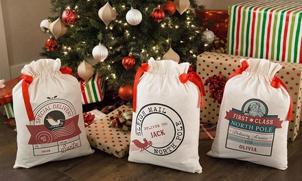 1, 2, 3, 5, or 10 Personalized Drawstring Santa Gift Bags from Qualtry (Up to 87%)