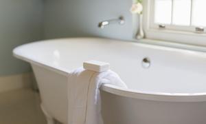 Custom Tub and Tile Resurfacing: Bathtub Re-Caulking, or Shower Pan or Bathtub Refinishing from Custom Tub and Tile Resurfacing (Up to 50% Off)