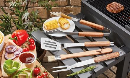 Tas met houten en metalen keukengerei voor de barbecue