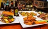 Friendly Confines, Metrowest - Metro West: $11 for $20 Worth of Sports Bar Fare for Two or More at Friendly Confines, Metrowest
