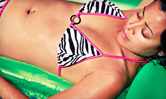 Hollywood Tans - Multiple Locations: Two or Four Mystic Spray Tans or Three or Six HT60 UV-Tans at Hollywood Tans in Marlton and Cherry Hill (Up to 69% Off)