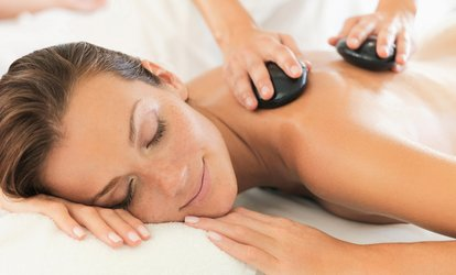 One or Three 60-Minute <strong>Hot Stone Massage</strong> with Optional Aromatherapy at Her Gifted Hands (Up to 52% Off)