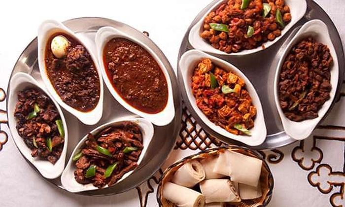 Lalibela Ethiopian Restaurant - Lalibela Restaurant: Ethiopian Cuisine at Lalibela Ethiopian Restaurant (Up to 52% Off). Four Options Available.