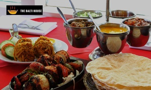 The Balti House: British-Indian Two-Course Dinner with Wine for Two ($39) or Four People ($75) at The Balti House (Up to $212 Value)