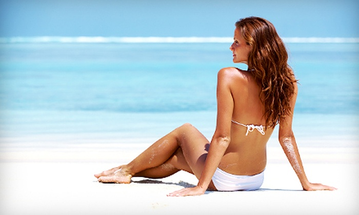 Sassy Tan & Spa - Multiple Locations: Month of UV Tanning or One or Three Airbrush Tans at Sassy Tan & Spa (Up to 63% Off)