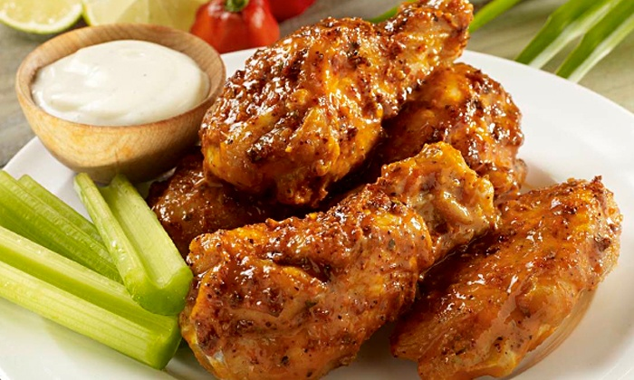 Hurricane Grill & Wings - Hurricane Grill & Wings: Wings, Burgers, and Tacos at Hurricane Grill & Wings (46% Off). Two Options Available.