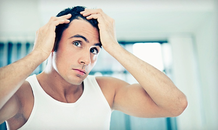 Giannotto Clinic - Tysons Central 7: 12 or 24 Laser Hair-Restoration Treatments with Consultation at Giannotto Clinic (Up to 81% Off)