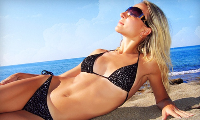The Tan Company Kansas City - Multiple Locations: Two Weeks of Unlimited Tanning in a Level 1 Bed or Two UV-Free Mystic HD Spray Tans at The Tan Company (Up to 59% Off)