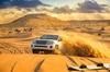 Red Dunes Desert Safari with Sandboarding and Camel Rides