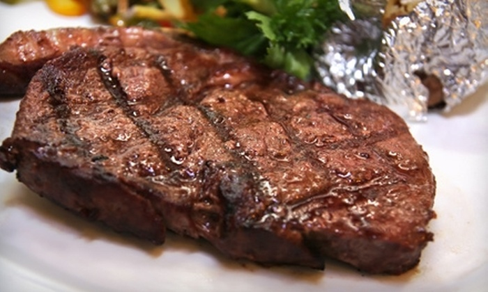 The Reef 'N Beef Restaurant and Lounge - Calgary: $7 for $15 Worth of Lounge Fare or $20 for $40 Worth of Fine Dining at The Reef 'N Beef Restaurant and Lounge