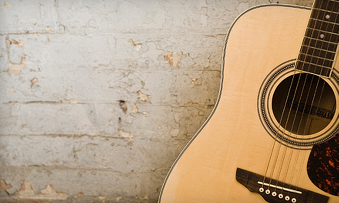 Creme Tangerine - Costa Mesa: $55 for Four 30-Minute Guitar Lessons at Creme Tangerine in Costa Mesa ($120 Value)