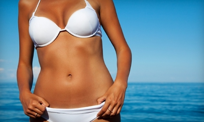 Tropical Island Tan - Stockton: $20 for a Spray-Tanning Session or Unlimited 30-Day Pass for Level-One UV Tanning at Tropical Island Tan (Up to $40 Value)