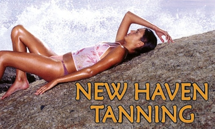 New Haven Tanning - Multiple Locations: $25 for 30 Days of Unlimited Tanning Plus One Bottle of Lotion or Two Spray Tans at New Haven Tanning (Up to $50 Value)