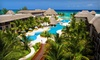 All-Inclusive Resort in Mexico with Airfare - University District: Five-, Six-, or Seven-Night All-Inclusive Stay at Reef Coco Beach in Playa del Carmen with Airfare