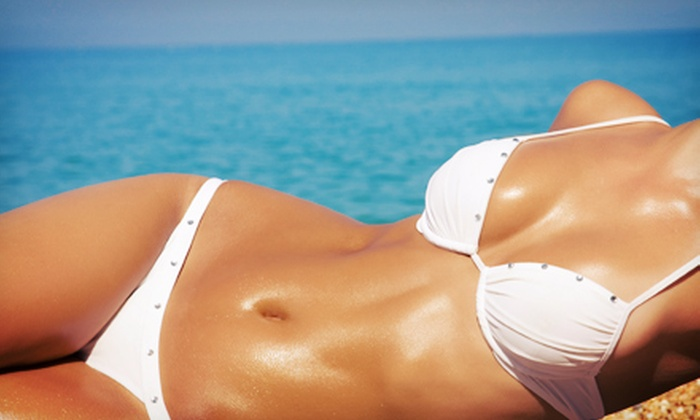 Natural Glo - Juneau Town: One or Three Natural Airbrush Tans at Natural Glo (Up to 57% Off)