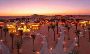 Arabian Nights Village: Desert Safari with Pool Access, Quad Bike and House Beverages or Overnight Stay Package at Arabian Nights Village