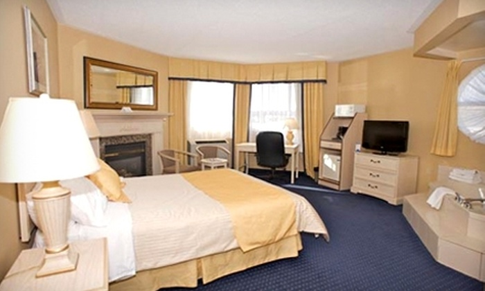 Monte Carlo Inns - Oakville Suites - Clarkson: $129 for a One-Night Stay and Dinner Package at Monte Carlo Inns - Oakville Suites in Oakville (Up to $239.90 Value)