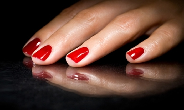 Amy-J's Faces and Feet - De Land: $15 for an OPI Axxium Soak-Off Gel-Polish Application at Amy-J's Faces & Feet in DeLand