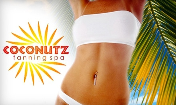 Coconutz Tanning Spa - Multiple Locations: $19 for One Spray Tan Session or Two Tanning Sessions in High Intensity Beds at Coconutz Tanning Spa (up to $39 value)