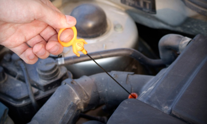 Auto Medics - Multiple Locations: $149 for Lifetime Oil Changes at Auto Medics ($300 Value). Two Locations Available.