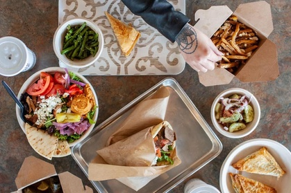 Greek Food and Drink at The Simple Greek  (Up to 30% Off). Two Options Available.