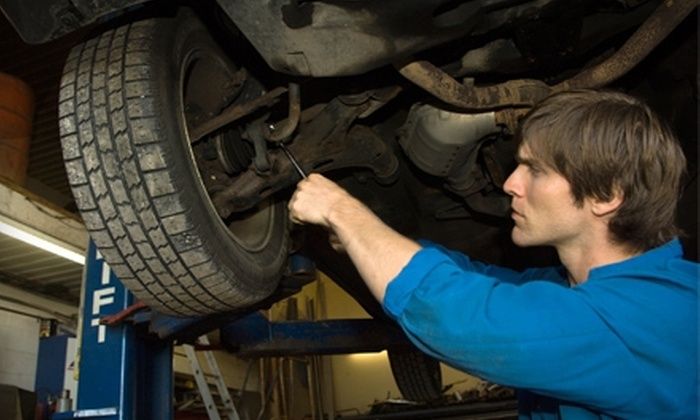AAMCO Dixie - West Louisville: $23 for an Oil Change and Tire Rotation at AAMCO Dixie (Up to $62.98 Value)