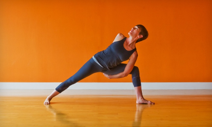 Dallas Yoga Center - Oak Lawn: One Month of Unlimited Yoga Classes or 10 or 20 Yoga Classes at Dallas Yoga Center (Up to 81% Off)