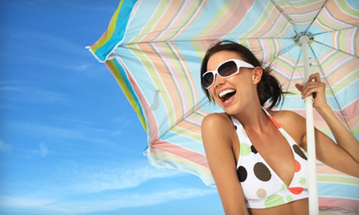 Hollywood Tans - Multiple Locations: Two or Four Mystic Tans or Three or Six UV Tanning Sessions at Hollywood Tans (Up to 69% Off)