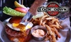 Lockdown Bar and Grill - West Town: $15 for $30 Worth of Gourmet Comfort Fare and Drinks at Lockdown Bar and Grill