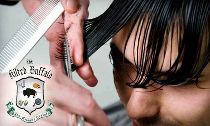 The Kilted Buffalo - Huntersville: $21 for a Men's Haircut and Gray Cover-Up ($43 Value), $19 for a Men's Haircut and Hot Lather Shave ($38 Value), or $11 for a Men's Haircut ($23 Value) at The Kilted Buffalo