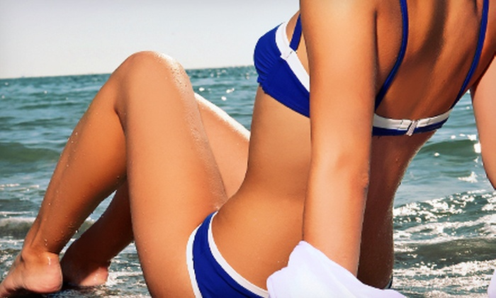Darque Tan - Multiple Locations: Two VersaSpa Spray Tans, Three Mystic Tans, or Five UV-Tanning Sessions at Darque Tan (Up to 84% Off)